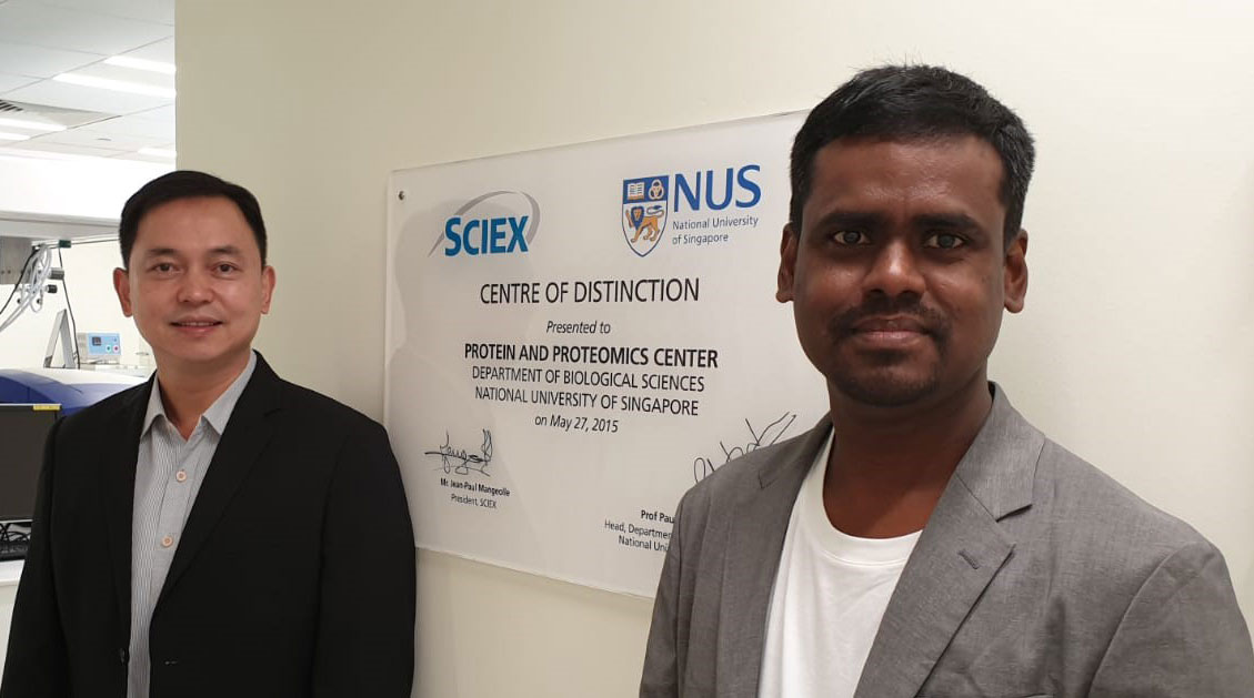 Dr. Lin Qingsong (left) and Purushothaman in the Protein and Proteomics Centre at The National University of Singapore